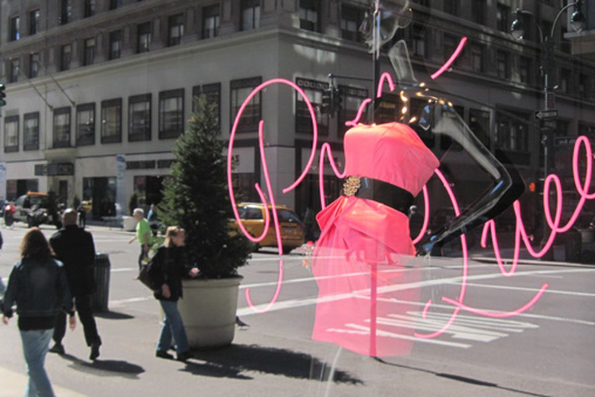 A prom dress in Lord & Taylor's window stands out against a crisp reflection of the street