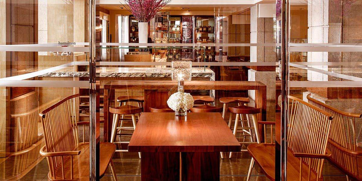 Bar area with wooden tables and furniture
