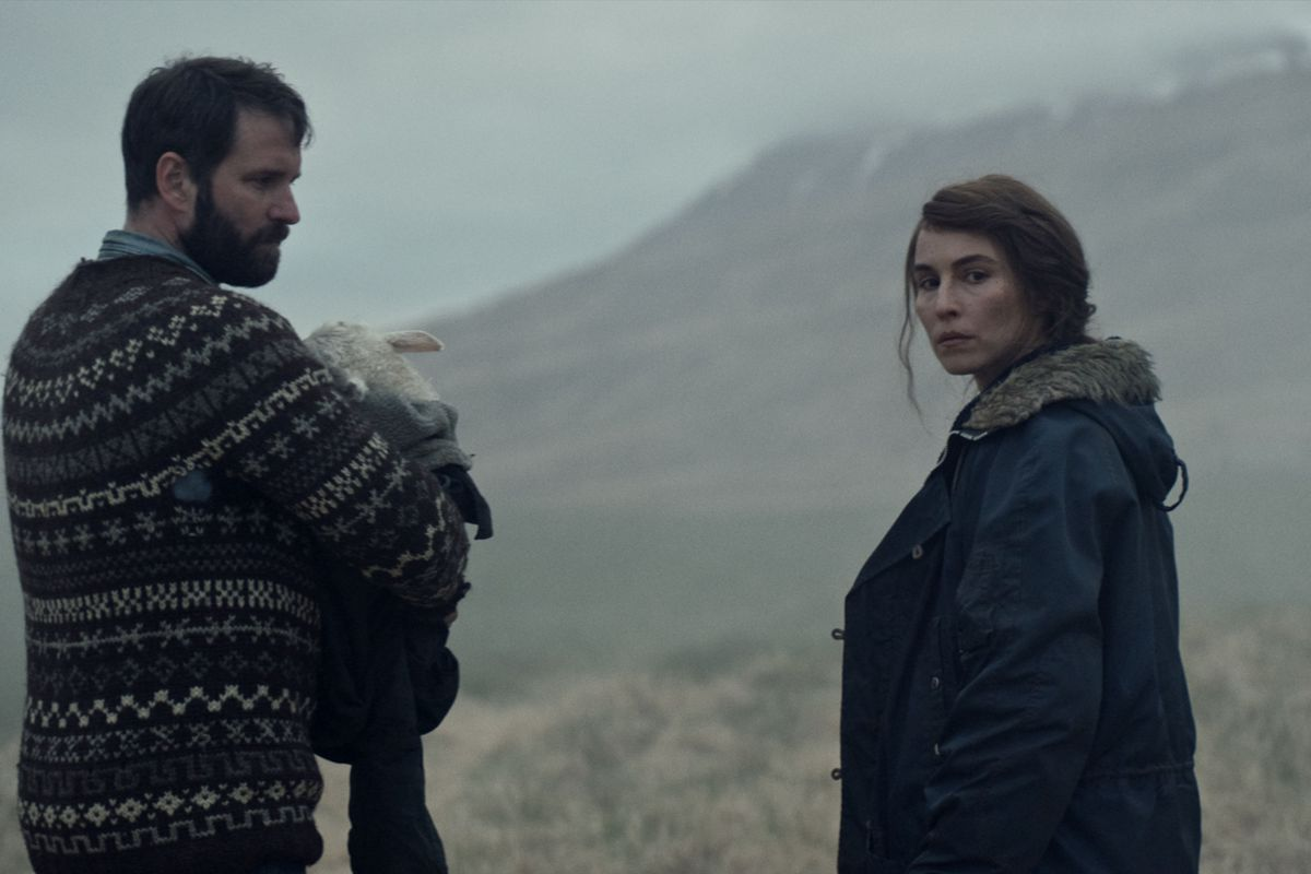 ingvar holding ada and maria looking over her shoulder against the icelandic wilderness