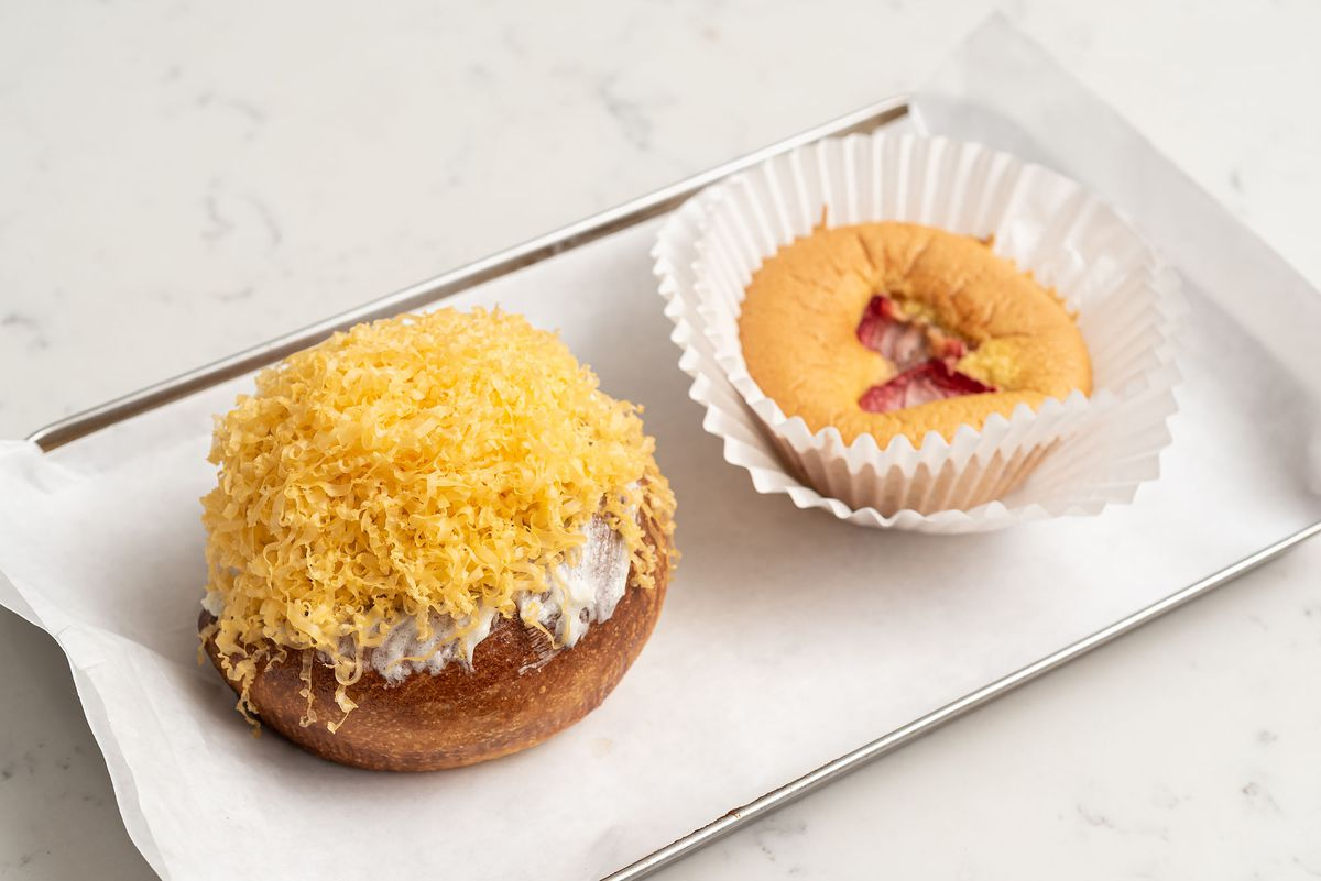 Two Filipino desserts on a metal tray, golden and ready.