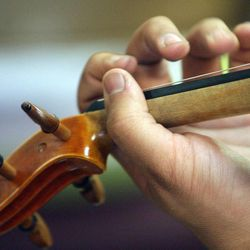 Gifted Music School orchestra students practice in Salt Lake City on April 13.
