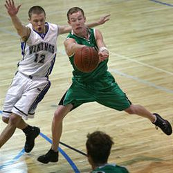 Provo's Kenyn Koop manages a pass despite pressure from Pleasant Grove's Zach Brady.