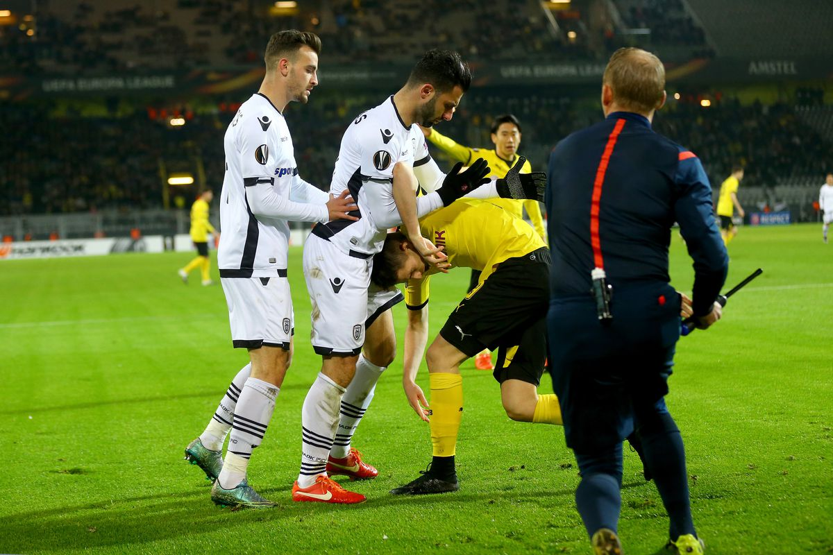 Dimitris Konstantinidis (PAOK) channels the thoughts of many Dortmund fans as he tosses aside Adnan Januzaj in a UEFA Europa League Group Match in December.