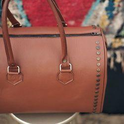 Oh Sooo Studly Brown Bowler Bag, $144.