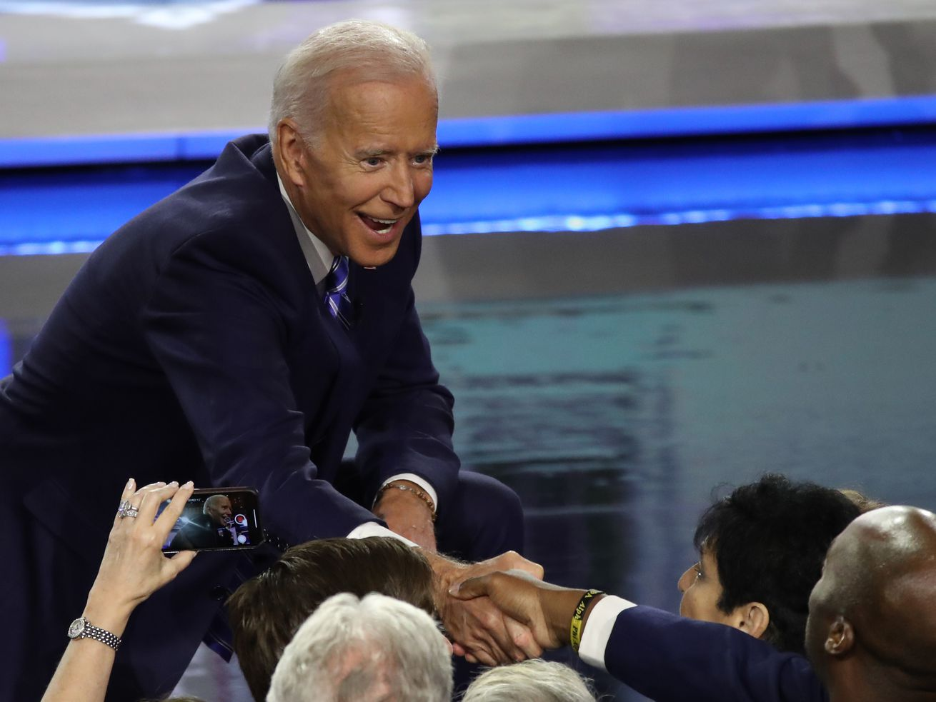 Former Vice President Joe Biden greets members of the audience after the second night of the first Democratic presidential debate on June 27, 2019 in Miami, Florida.