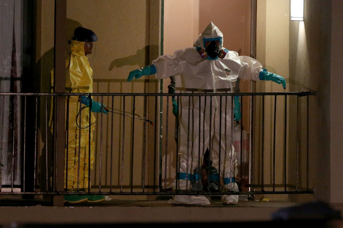 Members of the Cleaning Guys Haz Mat clean up company sanitizing the apartment where Ebola patient Thomas Duncan was staying before being admitted to a hospital in Dallas, Texas.