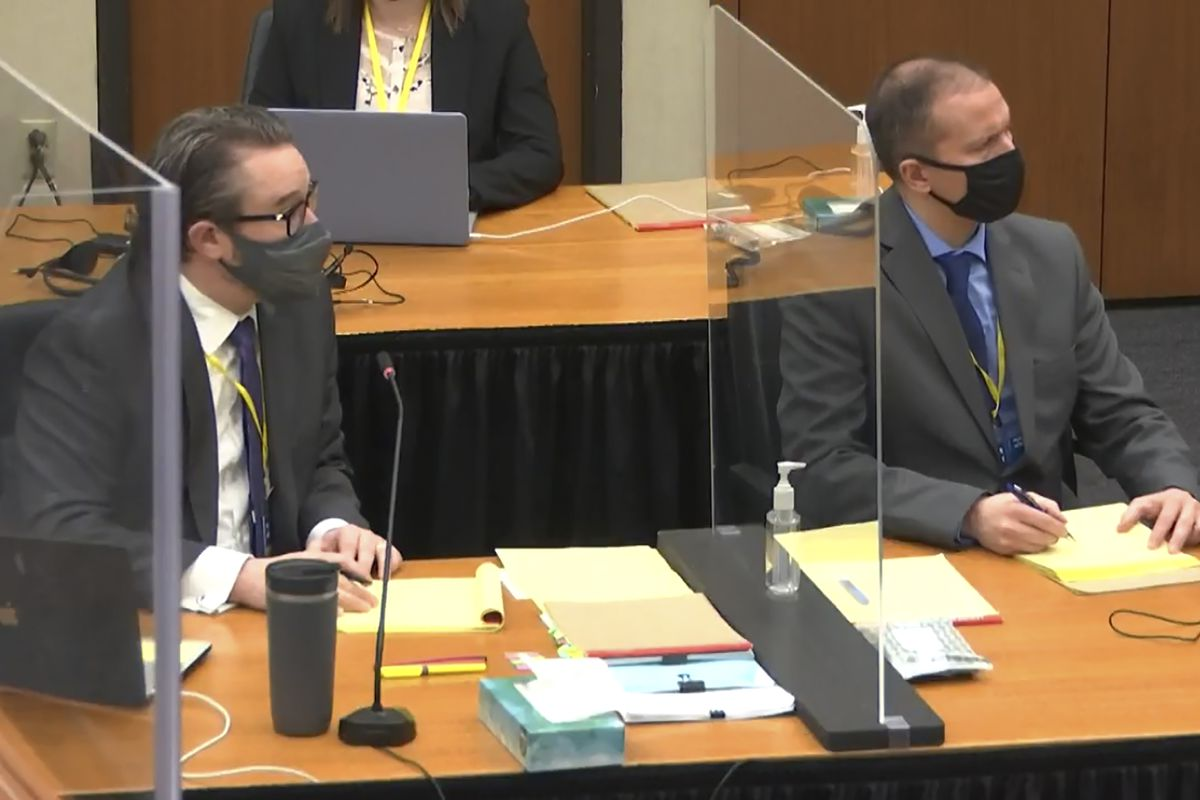 In this screen grab from video, defense attorney Eric Nelson, left, and defendant and former Minneapolis police officer Derek Chauvin, right, listen as Hennepin County Judge PeterCahill discusses pre-trial motions, prior to continuing jury selection, Friday, March 19, 2021, at the Hennepin County Courthouse in Minneapolis, Minn.