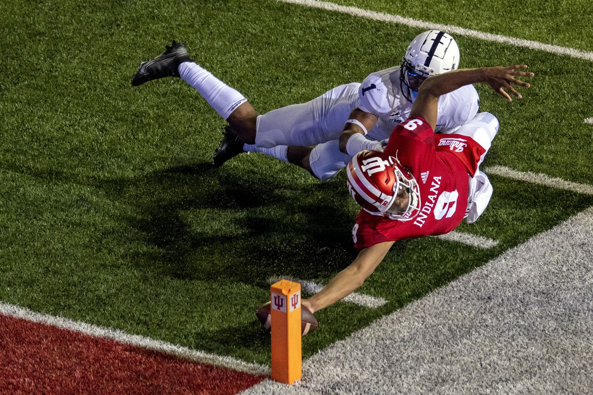 Indiana's Michael Penix Extends the football to hit a two point conversion against Penn State.