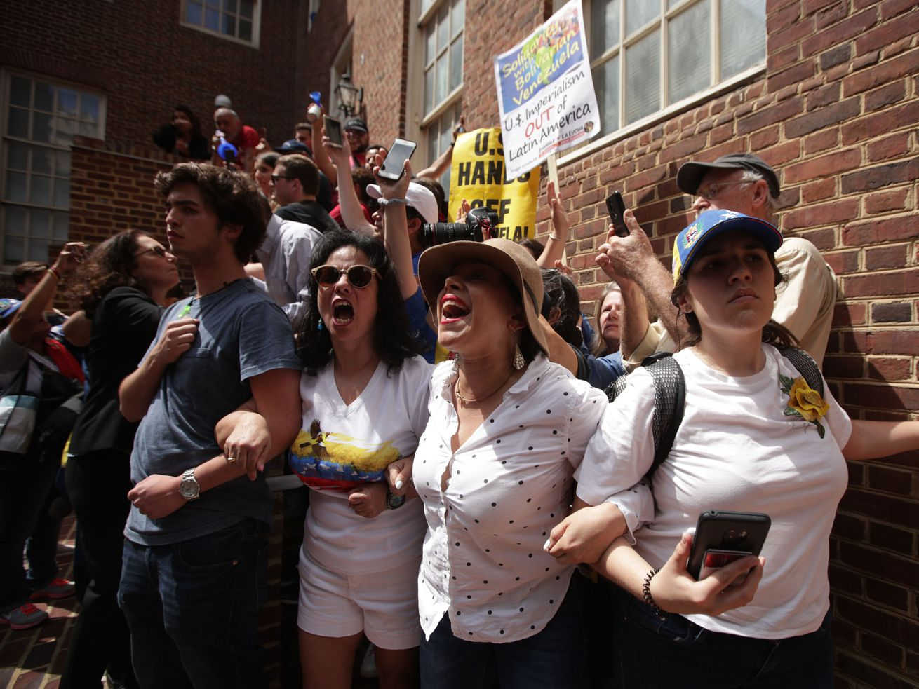 Supporters of Venezuelan opposition leader Juan Guaido block a back entrance of the Embassy of Venezuela on May 2, 2019 in Washington, DC.