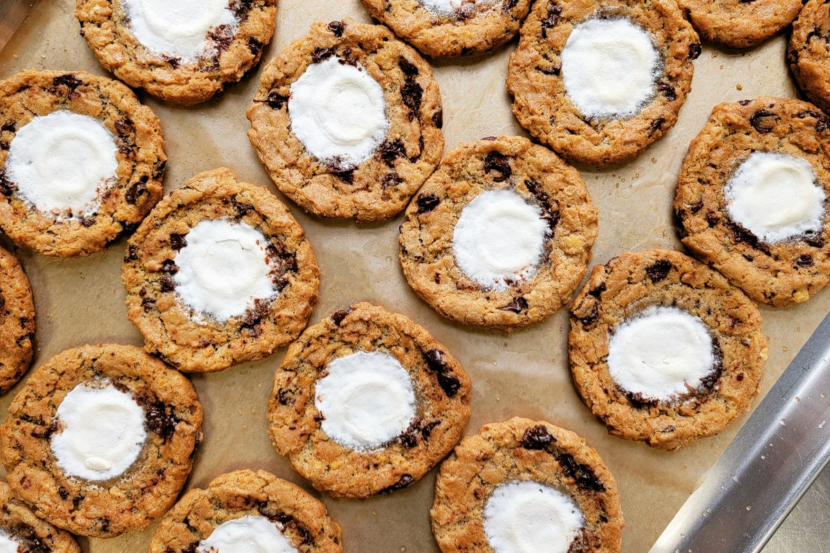 A sheet pan of chocolate chip cookies dolloped with marshmallow fluff from Hungry Hero