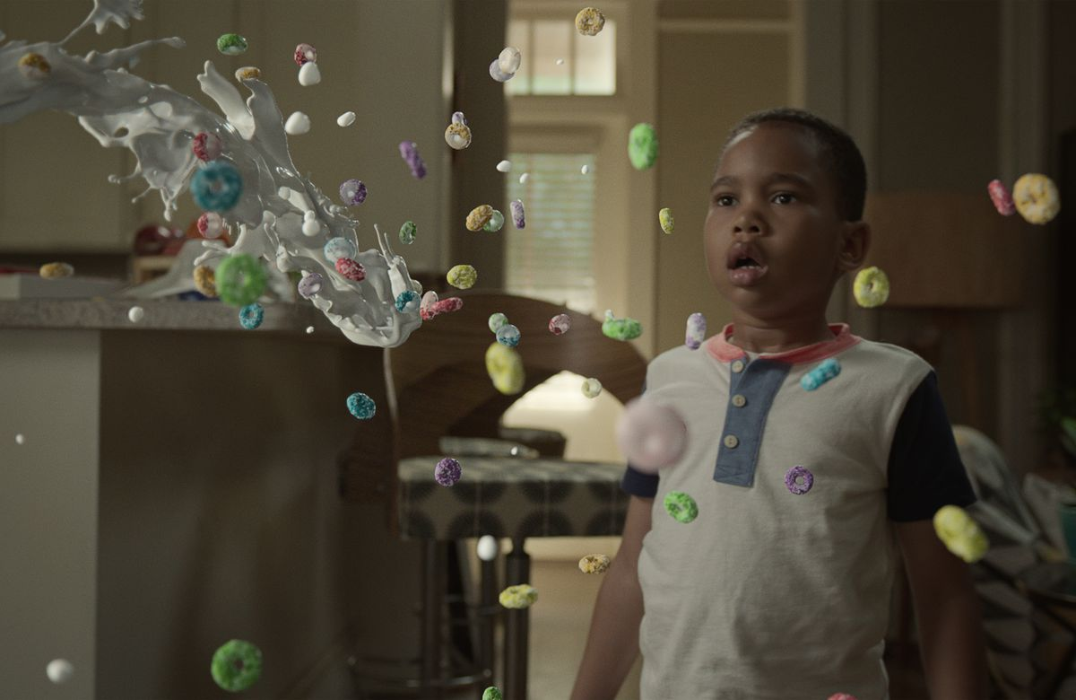 a young boy watches his cereal spill and suspend in mid-air. he is shocked.