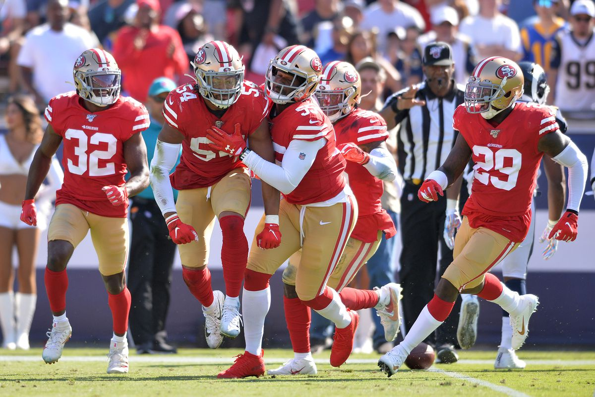 San Francisco 49ers free safety D.J. Reed, middle linebacker Fred Warner, defensive end Dee Ford, middle linebacker Kwon Alexander and strong safety Jaquiski Tartt celebrate on the field during the second half against the Los Angeles Rams at Los Angeles Memorial Coliseum.