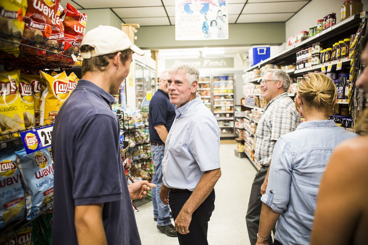 Gubernatorial candidate Shawn Moody talks with Michael Tribuzio, an employee of Swan Lake Grocery, while making a campaign visit to Swanville, Maine on August 3, 2018.