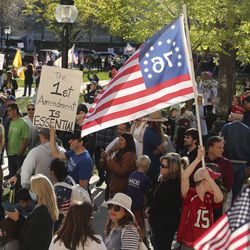 Utahns rally against a state stay-at-home request at the Salt Lake City-County Building in Salt Lake City on Saturday, April 18, 2020.