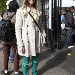 Meagan is wearing a coat and pants from Zara, a Target scarf, sunglasses from a street vendor, and Sperry Top-Siders.