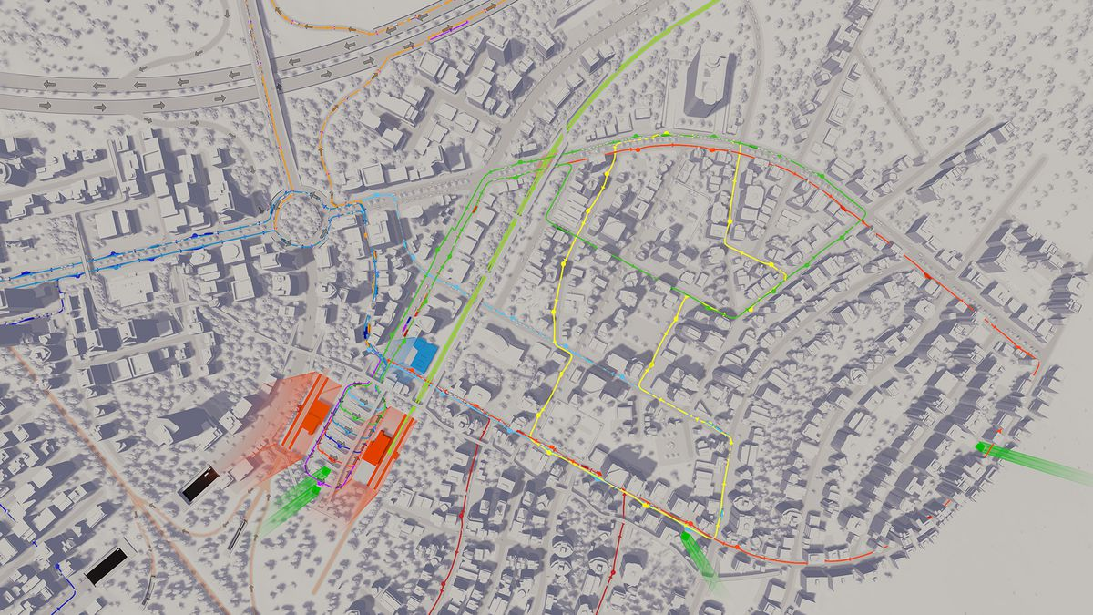 An aerial view of a city in Cities Skylines. The structures are all white boxes, and a colorful overlay shows how traffic is flowing on arterial roads.