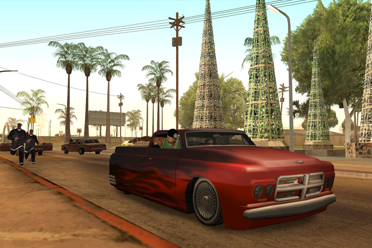 Players shoot from a car window while being chased in a screenshot from Grand Theft Auto: San Andreas.