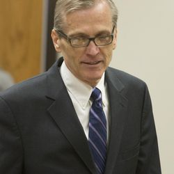 Martin MacNeill enters the courtroom for a trial on forcible sexual abuse, July 2, 2014.