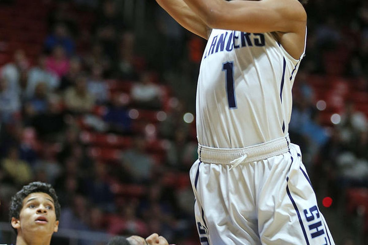 Layton's Julian Blackmon scores  over Skyview's Max Christensen  as Layton High School and Skyview High School play in the 5A State Boys Basketball State Tournament quarterfinals Thursday, March 3, 2016, in Salt Lake City.