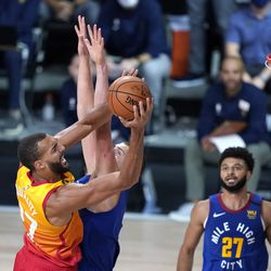Utah Jazz's Rudy Gobert (27) goes up for a shot as Denver Nuggets' Nikola Jokic defends during the second half of an NBA basketball first round playoff game Sunday, Aug. 23, 2020, in Lake Buena Vista, Fla.