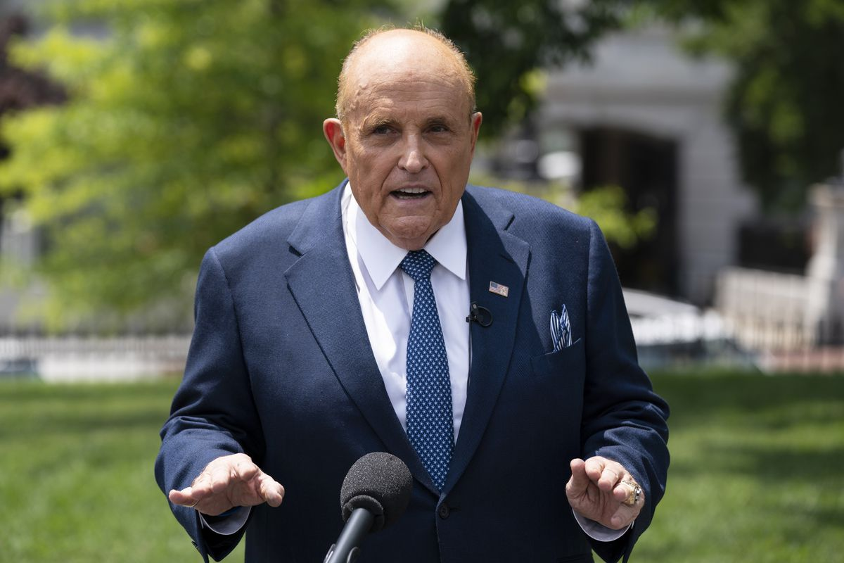 Rudy Giuliani, a personal attorney for President Donald Trump, talks with reporters outside the White House, Wednesday, July 1, 2020, in Washington.