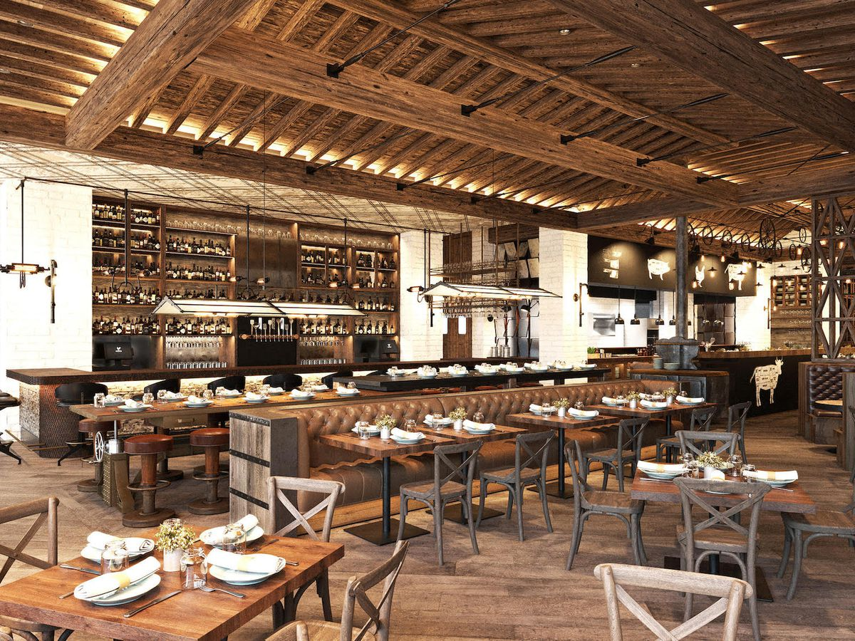 A rustic restaurant with farmhouse tables and chairs.