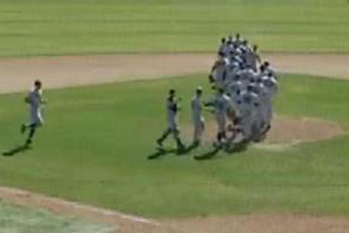 Oregon St. players celebrate sweeping Arizona on the mound at Hi Corbett.