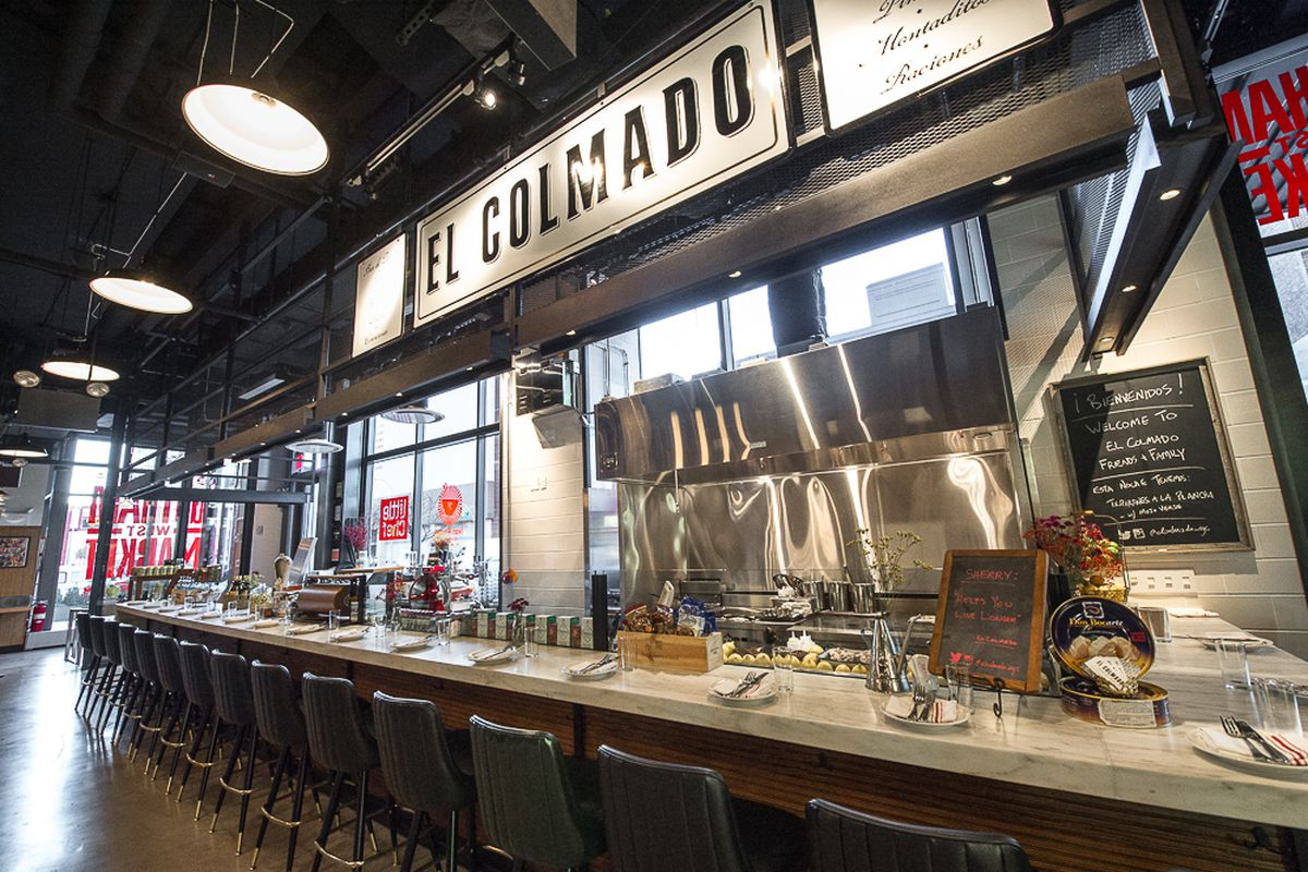 [The El Colmado counter at Gotham West Market in Hell's Kitchen]