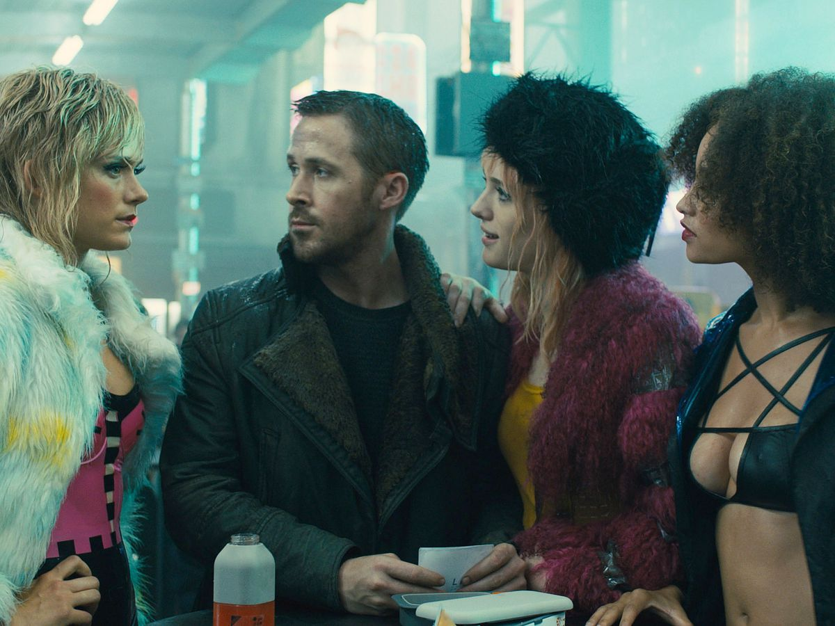 Ryan Gosling and other characters wearing coats in 'Blade Runner 2049'