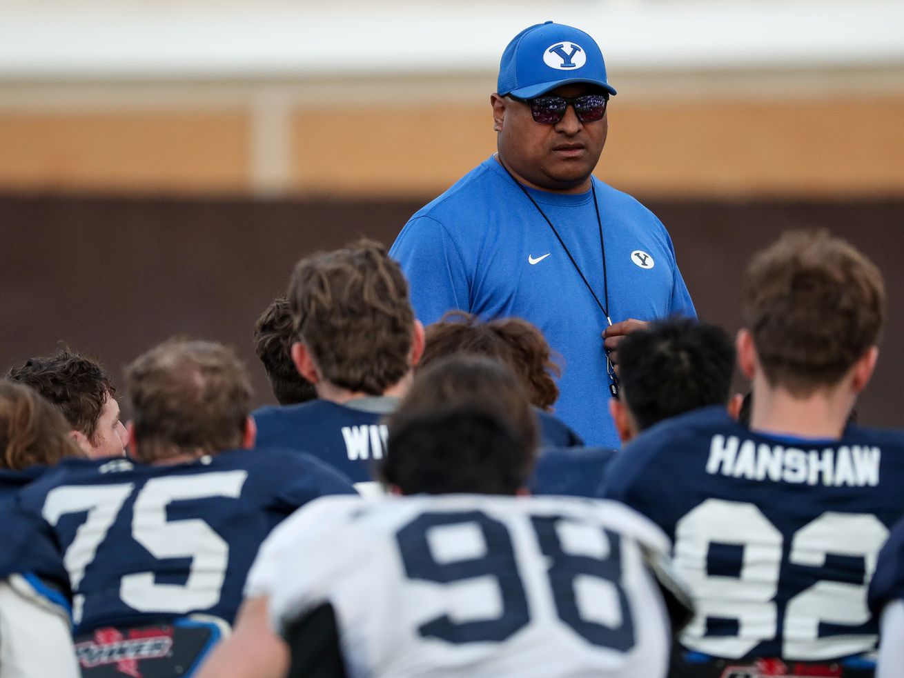 Head coach Kalani Sitake talks to players during Brigham Young University football practice in Provo on Friday, March 6, 2020.