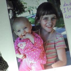 AngelLee Stubbs, left, with older sister LeVonica, 9, in a photograph on a poster hanging in their mother's room at Kolob Regional Care and Rehabilitation Center.