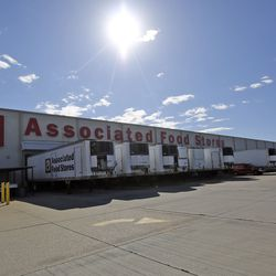 Trucks are lined up to be loaded at the Associated Foods Stores distribution warehouse in Farr West, Weber County, on Tuesday, March 17, 2020.