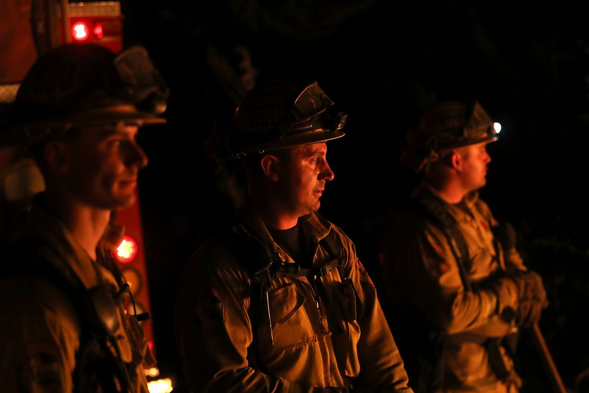 CalFire firefighters monitor a firing operation as they battle the Tubbs Fire on October 12, 2017, near Calistoga, California.