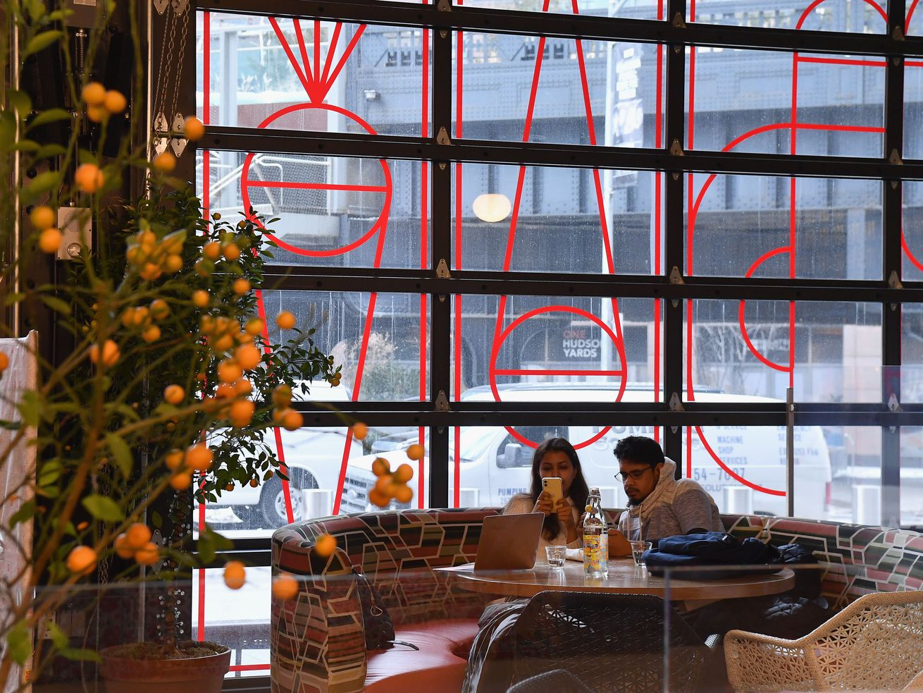 A couple dines inside a restaurant at Hudson Yards in New York City