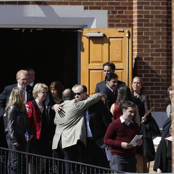 People greet and hug following the memorial service for Deedee Corradini at Wasatch Presbyterian Church in Salt Lake City, Monday, March 9, 2015.
