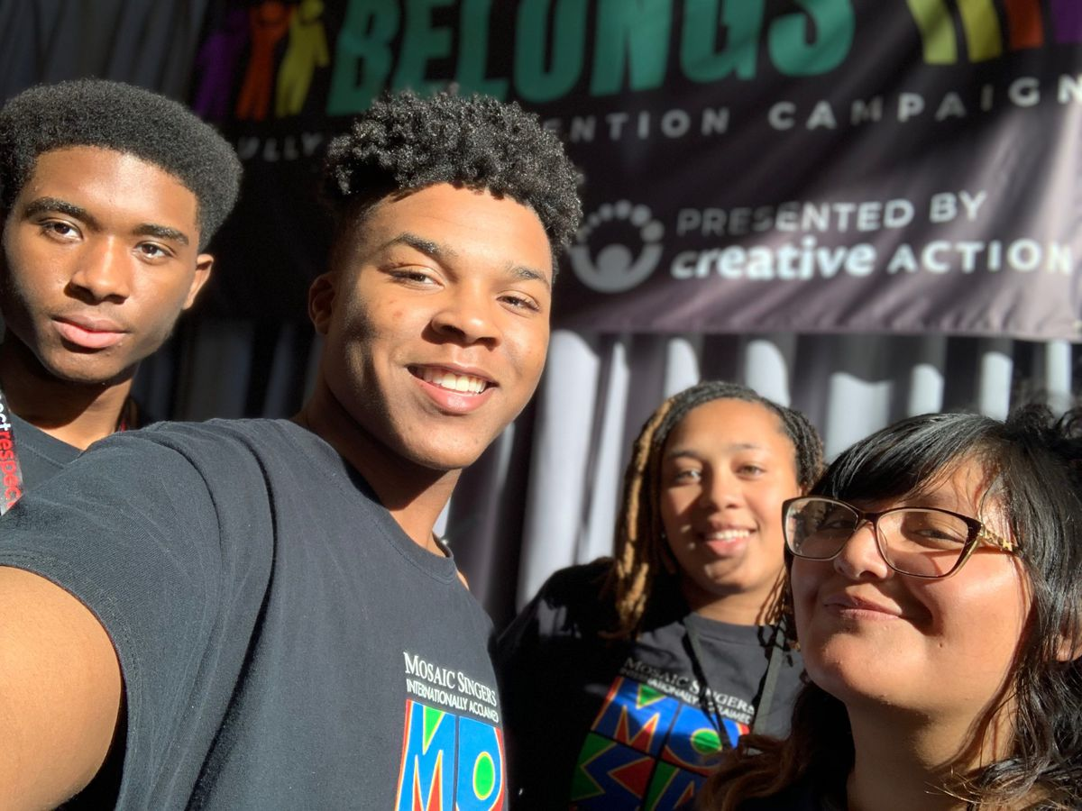 Sam Fairley, a 17-year-old high school senior in Detroit, with members of his choir, the Mosaic Singers.