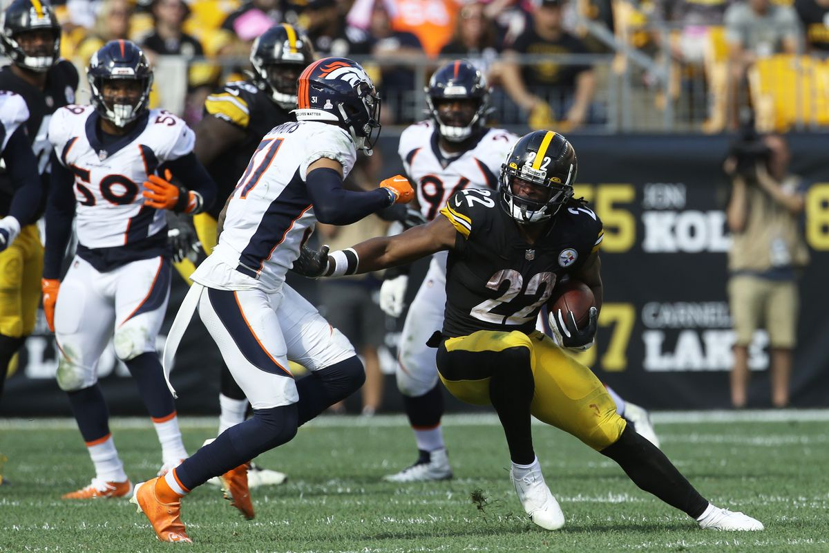 Pittsburgh Steelers running back Najee Harris (22) carries the ball against Denver Broncos free safety Justin Simmons (31) during the third quarter at Heinz Field.