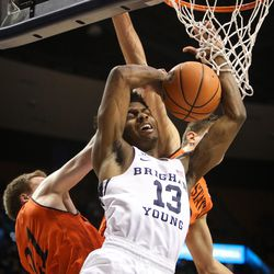 Brigham Young Cougars guard Kajon Brown (13) is fouled as he makes the shot by Idaho State Bengals guard Jared Stutzman (21) and center Novak Topalovic (13) as BYU takes on Idaho State at the Marriott Center in Provo on Thursday, Dec. 21, 2017.