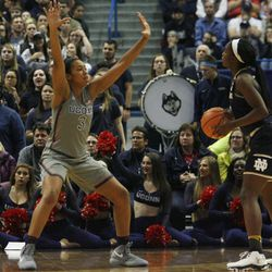 UConn's Megan Walker (3) guards a Notre Dame player during the Notre Dame Fighting Irish vs UConn Huskies women's college basketball game in the Women's Jimmy V Classic at the XL Center in Hartford, CT on December 3, 2017.