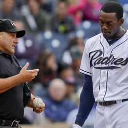 San Diego Padres' Cameron Maybin, right, pleads his case with umpire Eric Cooper after striking out to end the third inning in a baseball game against the Arizona Diamondbacks,Wednesday, April 11, 2012, in San Diego.