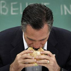 FILE - In this April 27, 2012, file photo Republican presidential candidate, former Massachusetts Gov. Mitt Romney, eats a burger before a roundtable discussion with students at Otterbein University in Westerville, Ohio. After days of closed-door fundraisers, Romney reintroduced himself to a nation, his first public appearance since becoming the presumptive Republican presidential nominee, and offered a window into his campaign's evolving strategy as he moves beyond the bitter GOP primary.  (AP Photo/Jae C. Hon, File)