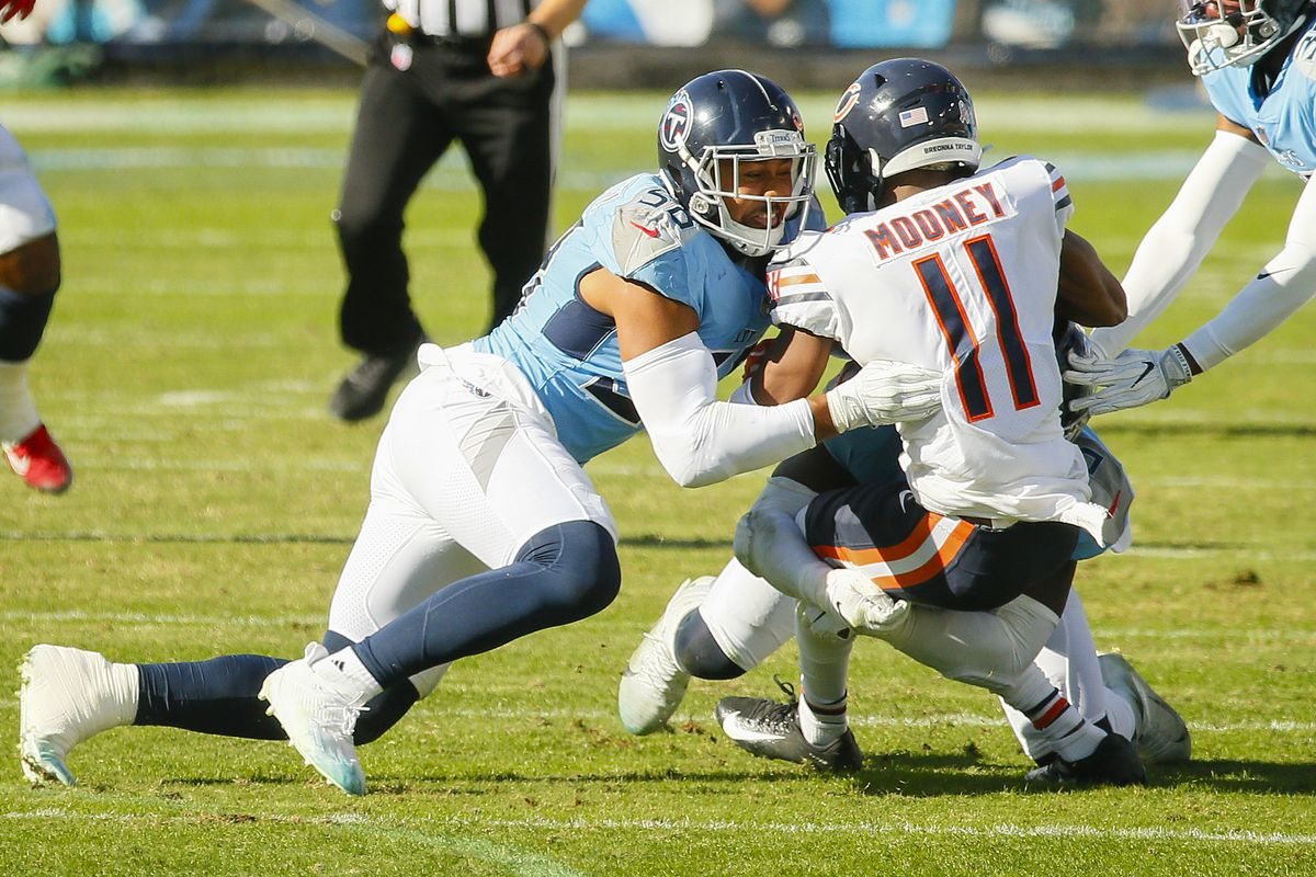 Harold Landry #58 of the Tennessee Titans tackles Darnell Mooney #11 of the Chicago Bears at Nissan Stadium on November 08, 2020 in Nashville, Tennessee.