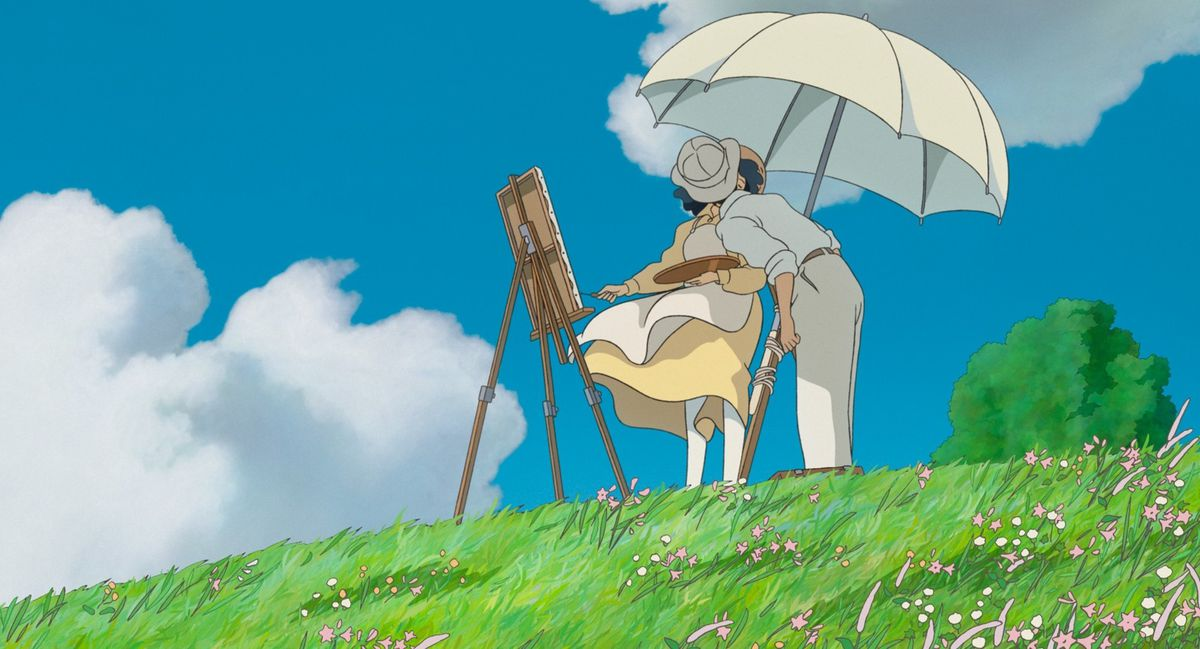 in a scene from the anime film The Wind Rises, a man in a white dress shirt and khakis kisses a woman in a yellow dress under a beige umbrella next to an easel on a grassy hill