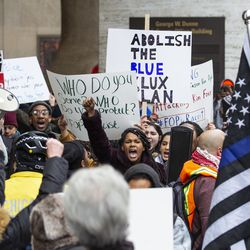 Fraternal Order of Police members and supporters face counter-protesters. | Ashlee Rezin/Sun-Times