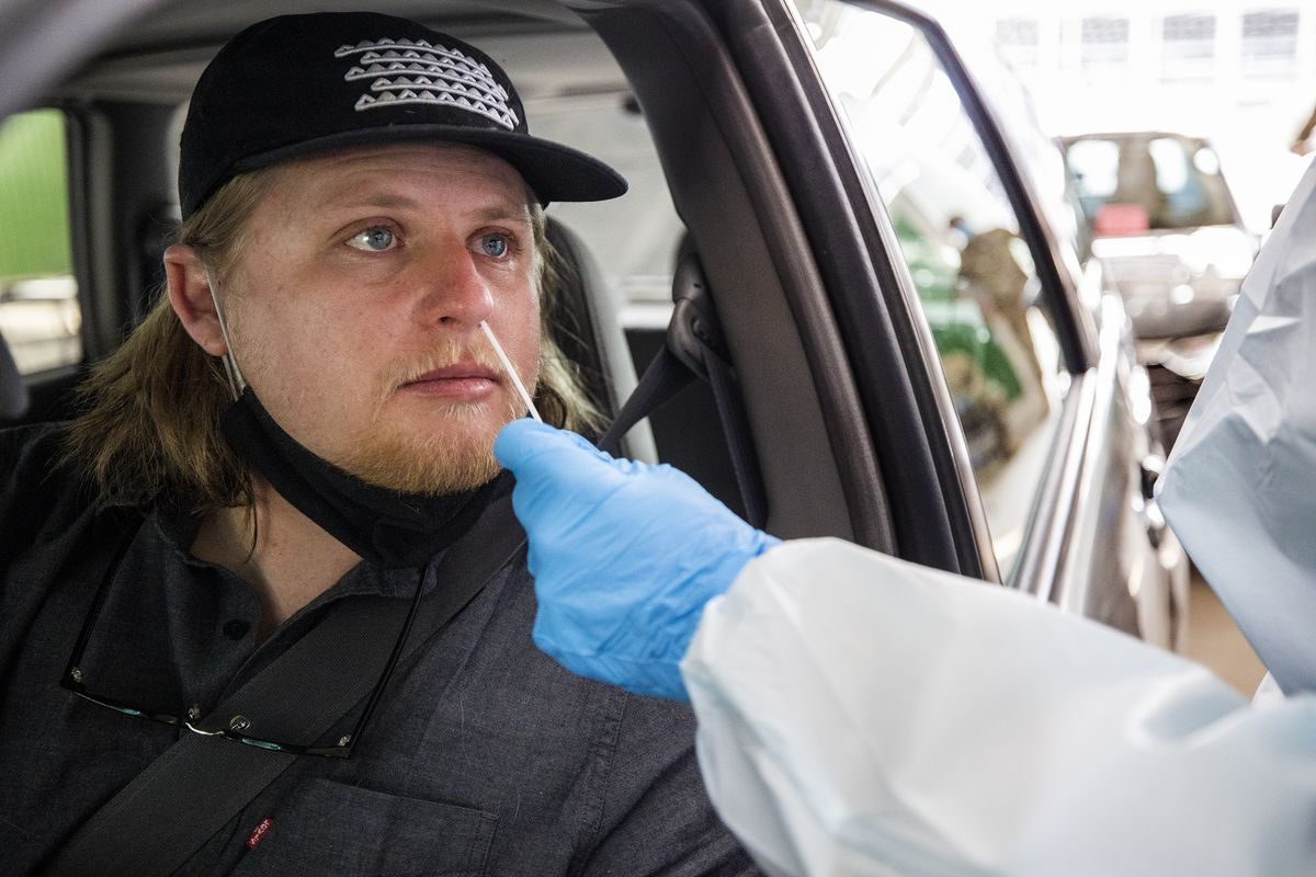 Corey Clark receives a COVID-19 nasal swab test at the Utah State Fairpark. The novel coronavirus hasn't gone away just yet. In fact, it's still very much out there.