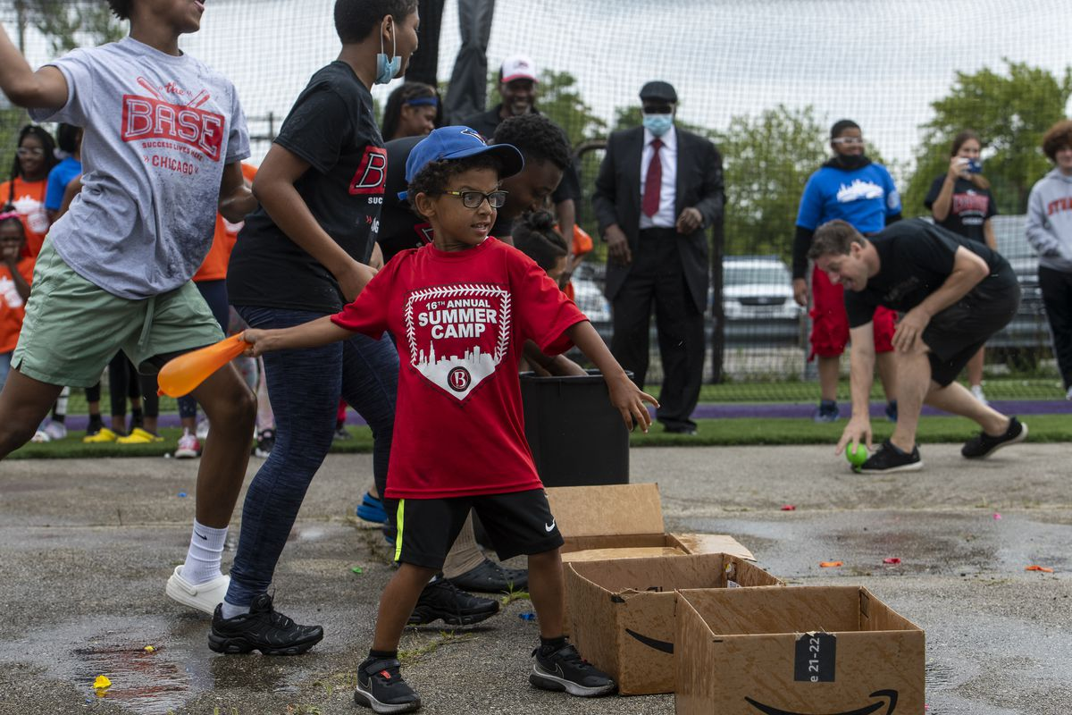 West Side youth had a water balloon fight with Chicago police officers from the Chicago Police Knights Baseball Club on Friday, July 16, 2021.