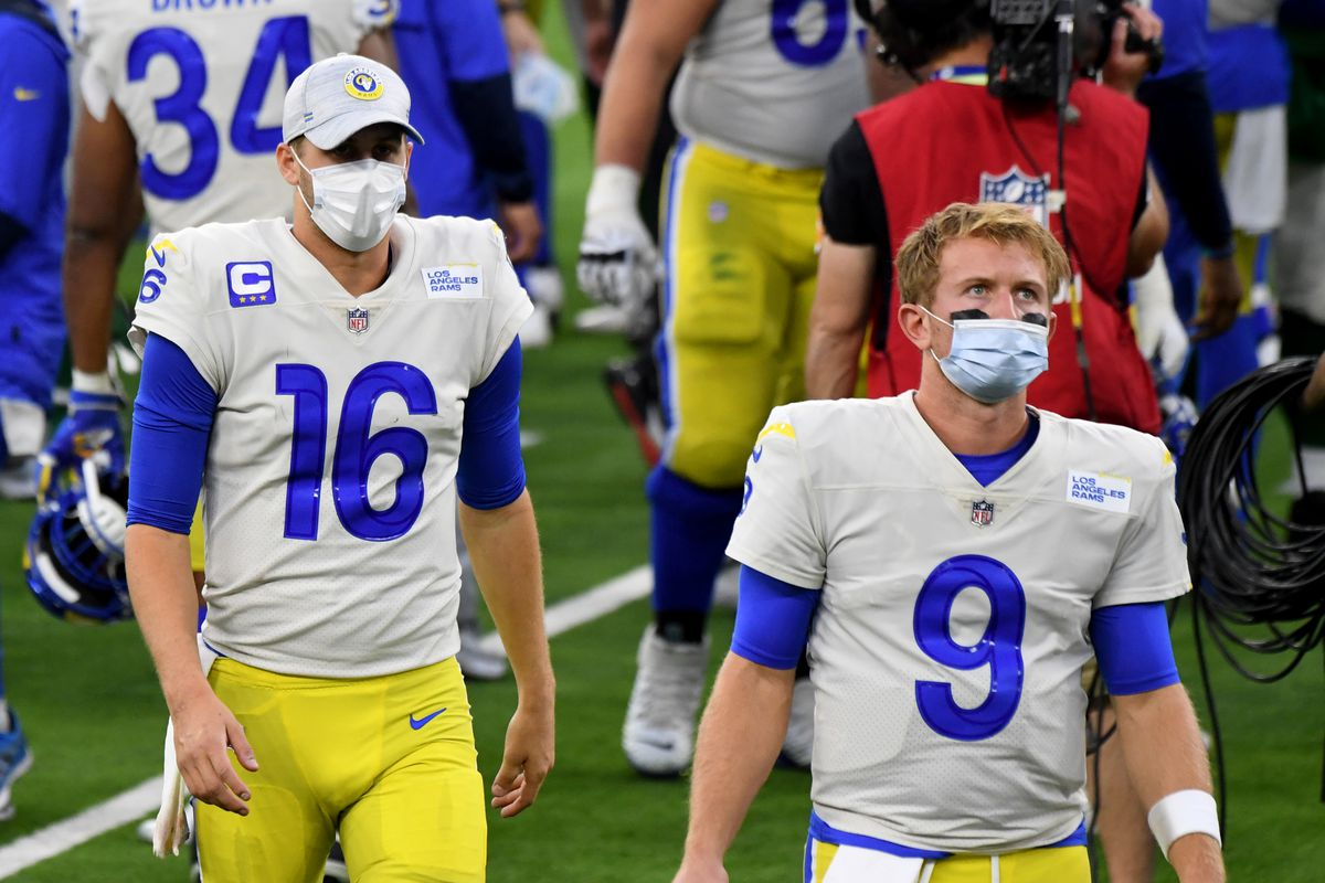 Quarterback Jared Goff #16 along with quarterback John Wolford #9 of the Los Angeles Rams walk off the field as the New York Jets defeated the Los Angeles Rams 23-20 during a NFL football game at SoFi Stadium in Inglewood on Sunday, December 20, 2020.
