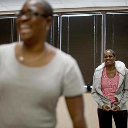 In a Wednesday, April 25, 2012 photo, cancer survivors Hastine Reese, 50, of Stockbridge, Ga., right, and Vivian Cox, 48, of Stone Mountain, Ga., talk after an exercise class, in Atlanta. A cancer diagnosis often inspires people to exercise and eat healthier. Now the experts say there's evidence that that may help the disease from returning. The American Cancer Society on Thursday issued new guidelines urging doctors to talk to their cancer patients about slimming down if they're fat, eating right and doing some exercise.