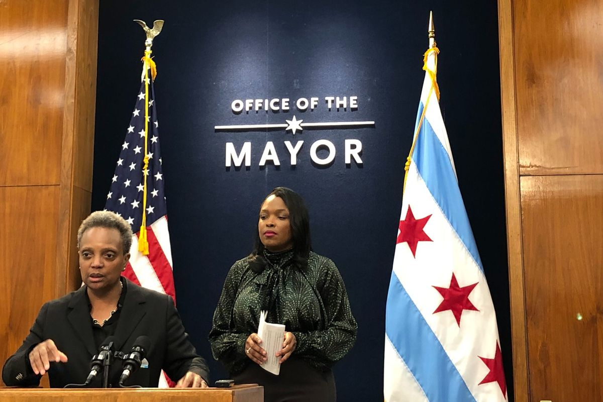 Chicago Mayor Lori Lightfoot speaks at the podium, with schools chief Janice Jackson standing behind, on Oct .15, 2019