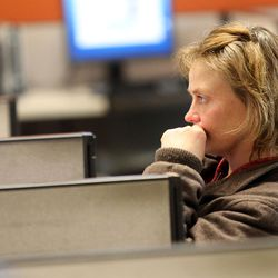 Katrina Oliver looks for housing assistance at the Utah State Metro Employment Center in Salt Lake City on Friday, Dec. 11, 2015.